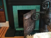 FIREPLACES THROUGHOUT WERE REPURPOSED; IN THE TURQUOISE ROOM, THE FIREPLACE HOUSES ELECTRONICS
